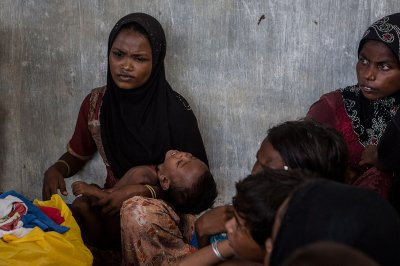 rohingya boat migrants Indonesia rescued