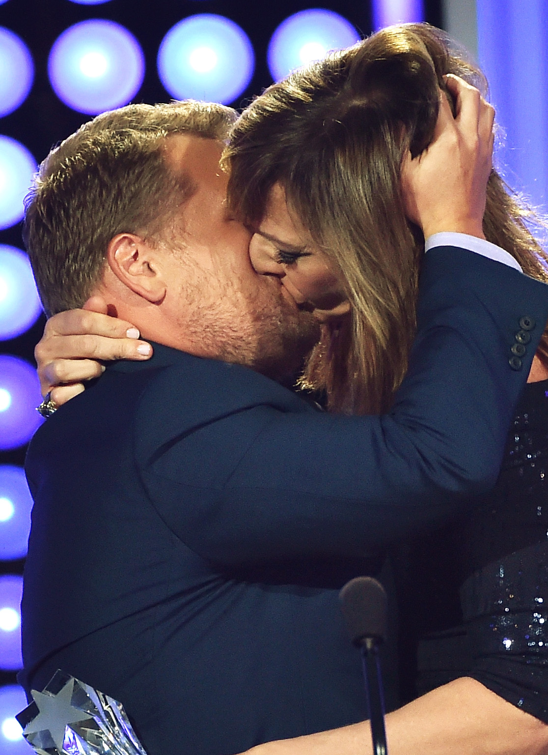 Allison Janney passionately kisses James Corden