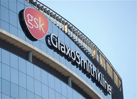 A GlaxoSmithKline logo is seen outside one of its buildings in west London