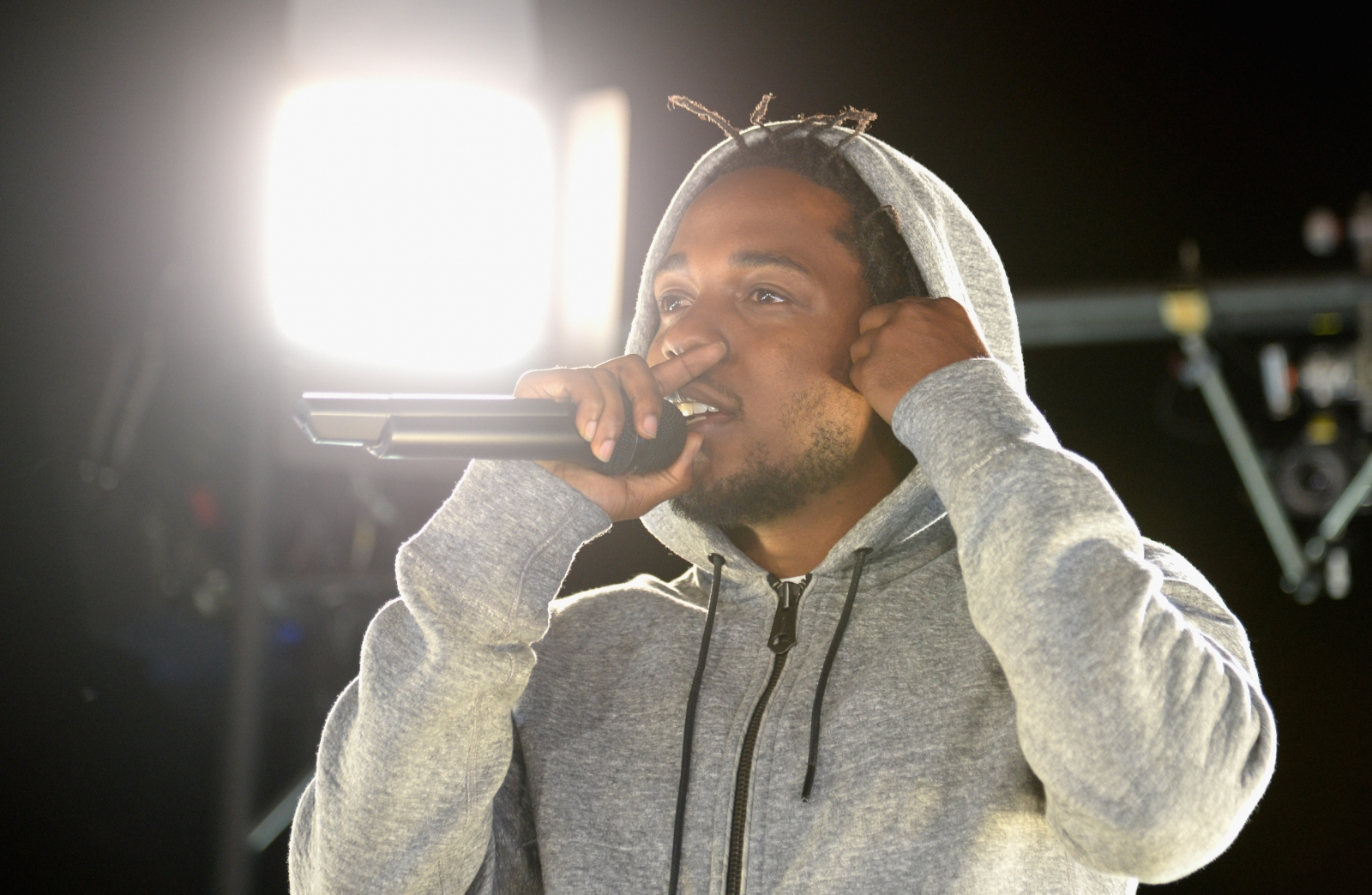 Kendrick Lamar kicks fan off stage