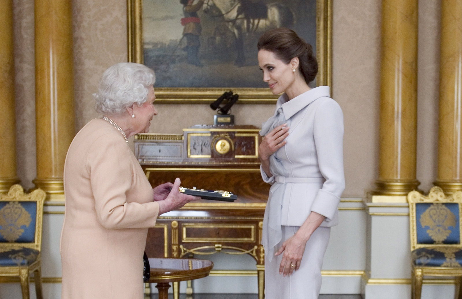 Angelina Jolie receiving a damehood in 2014