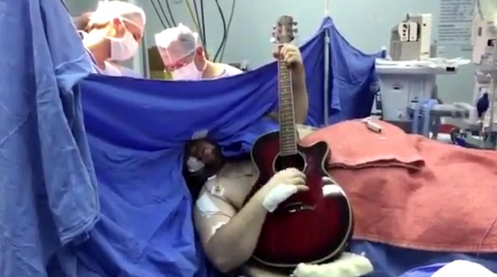 Brazilian guitarist plays during operation