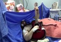 Brazilian guitarist plays during operation