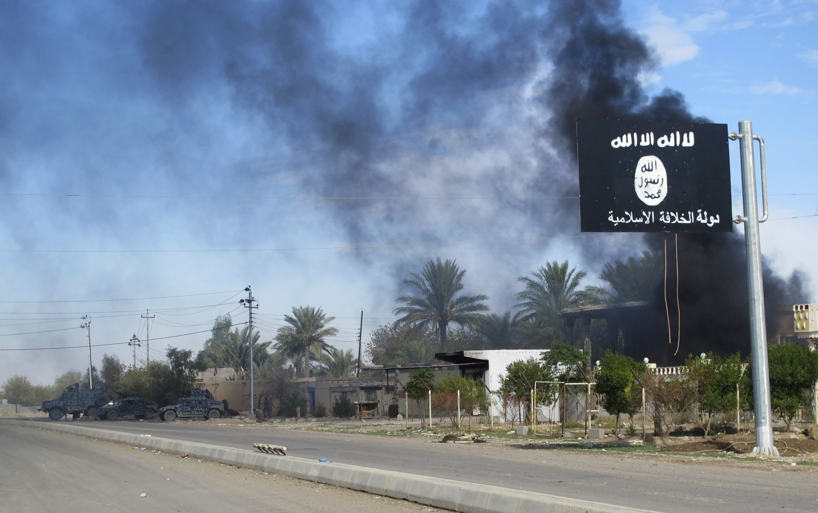 Isis flag flies over Saadiya, Iraq