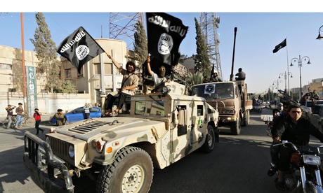Isis fighters drive a US Humvee