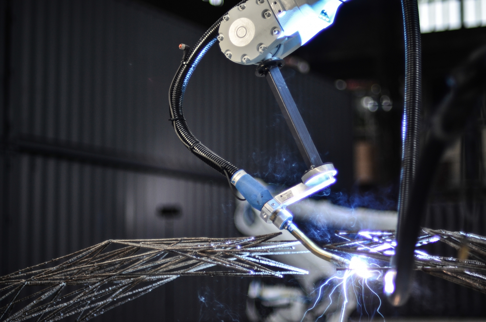 The robotic arm 3D prints and welds