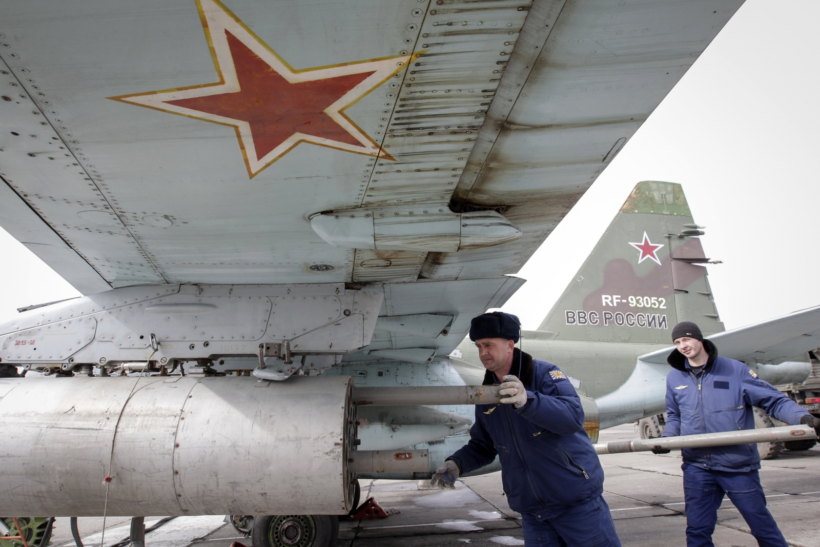 Russian servicemen load air-to-ground missiles
