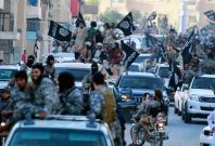 Isis militants parade in Raqqa, Syria