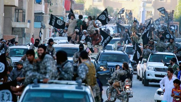 Isis militants parade in Raqqa, Syria