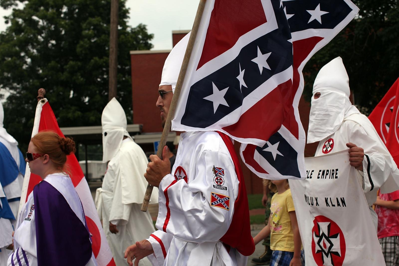 Klan members hold