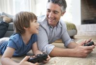 dad and son playing video games