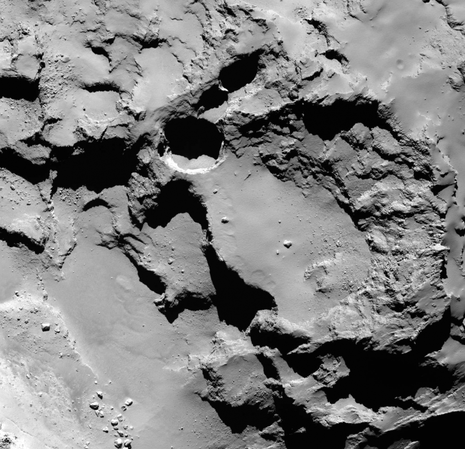 sinkholes rosetta comet