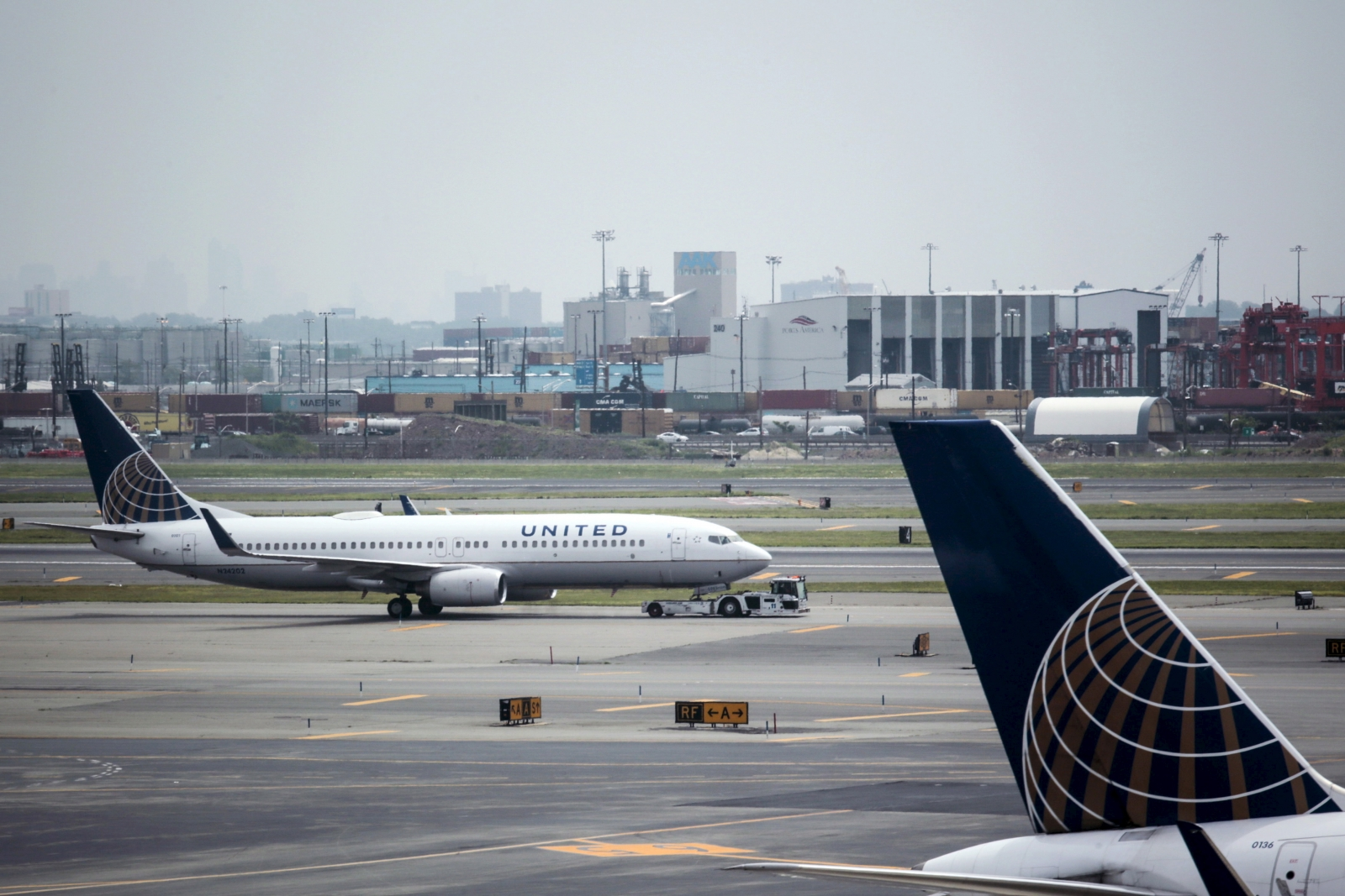 United Airlines flight delayed after stewardess forgets her mobile phone