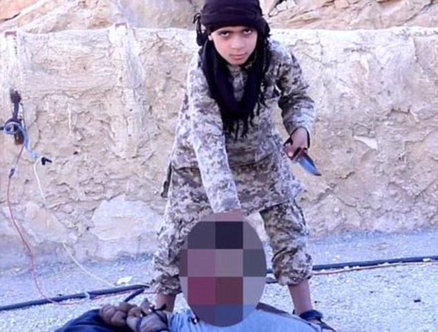 Isis: Shocking video shows Islamic State child executioner beheading