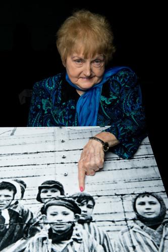 Eva Kor poses with an image