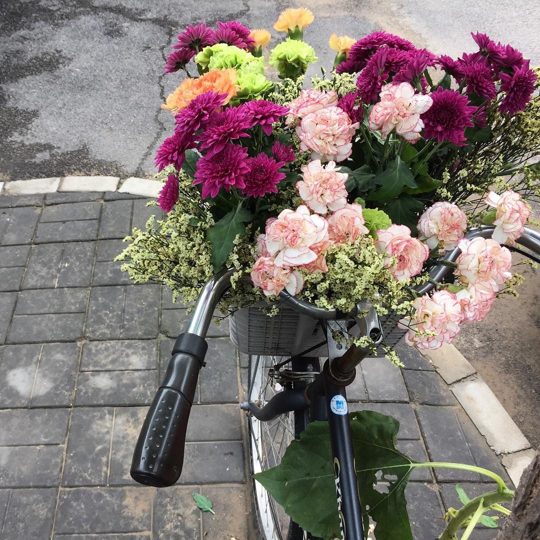The basket of flowers outside his house