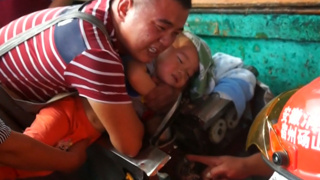 China: Toddler gets arm caught in functioning meat grinder ...