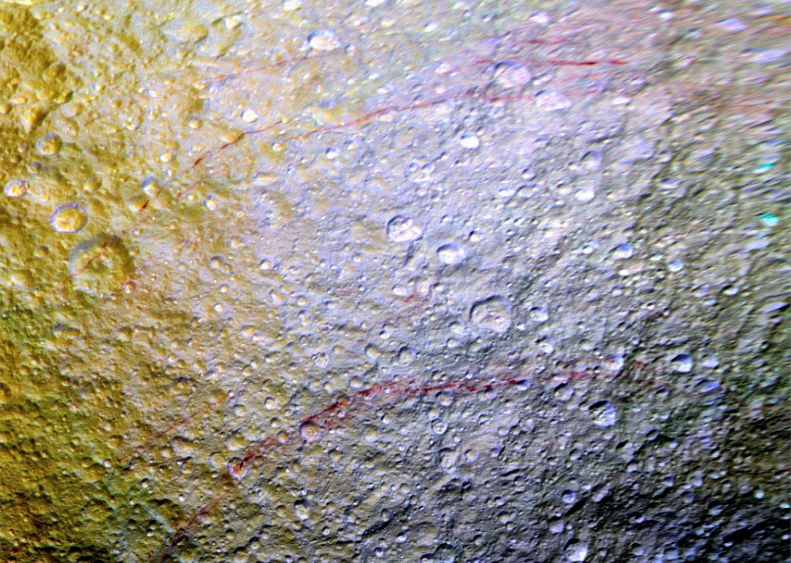 red scars on Saturn moon