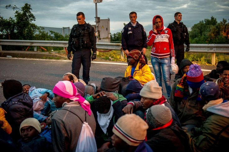 French gendarmes face migrants