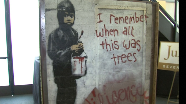 Detroit banksy mural auctioned in beverly hills for Detroit mural factory