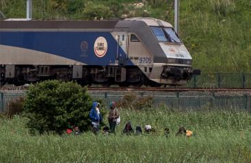 Calais migrants by Eurotunnel train