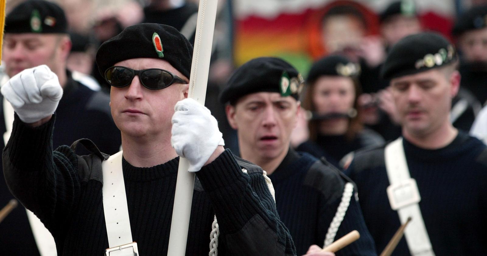 Sinn Fein supporters march in Strabane