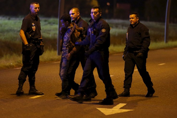 French riot police detain migrant