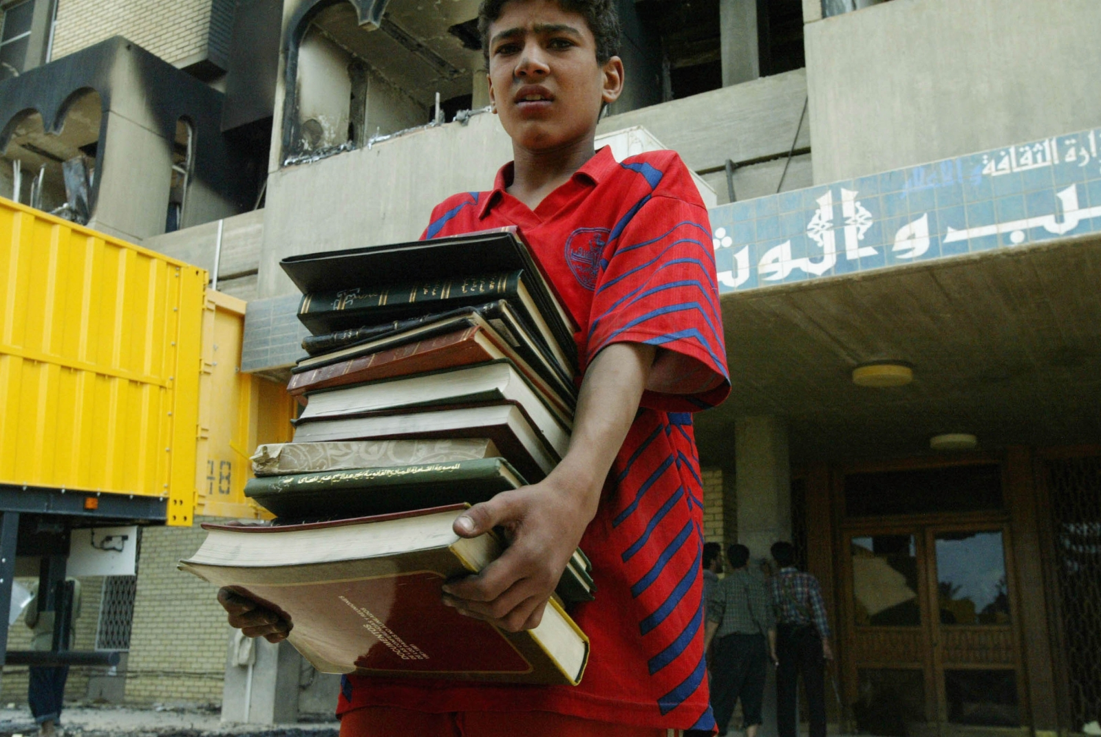 An Iraqi boy recovers books from Baghdad's