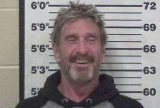 John McAfee arrest mugshot