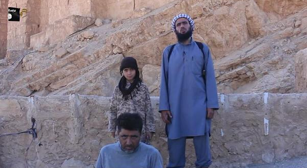 Syria child soldier beheading army officer
