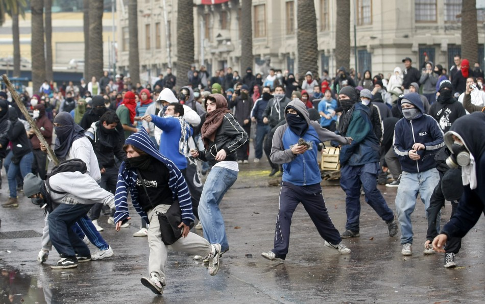 Students take part in a protest against the government to demand changes in the public state education system in Valparaiso city