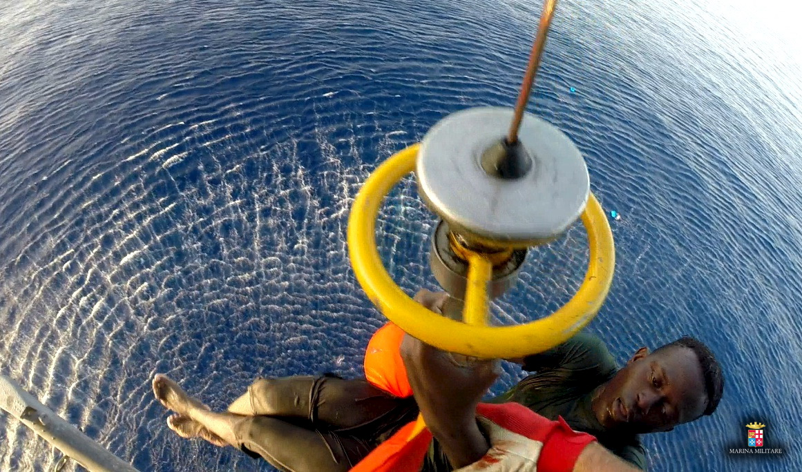 Italian navy helicopter rescue migrants