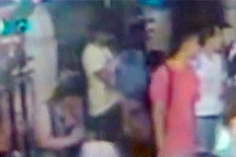 Red-shirted suspect caught on camera