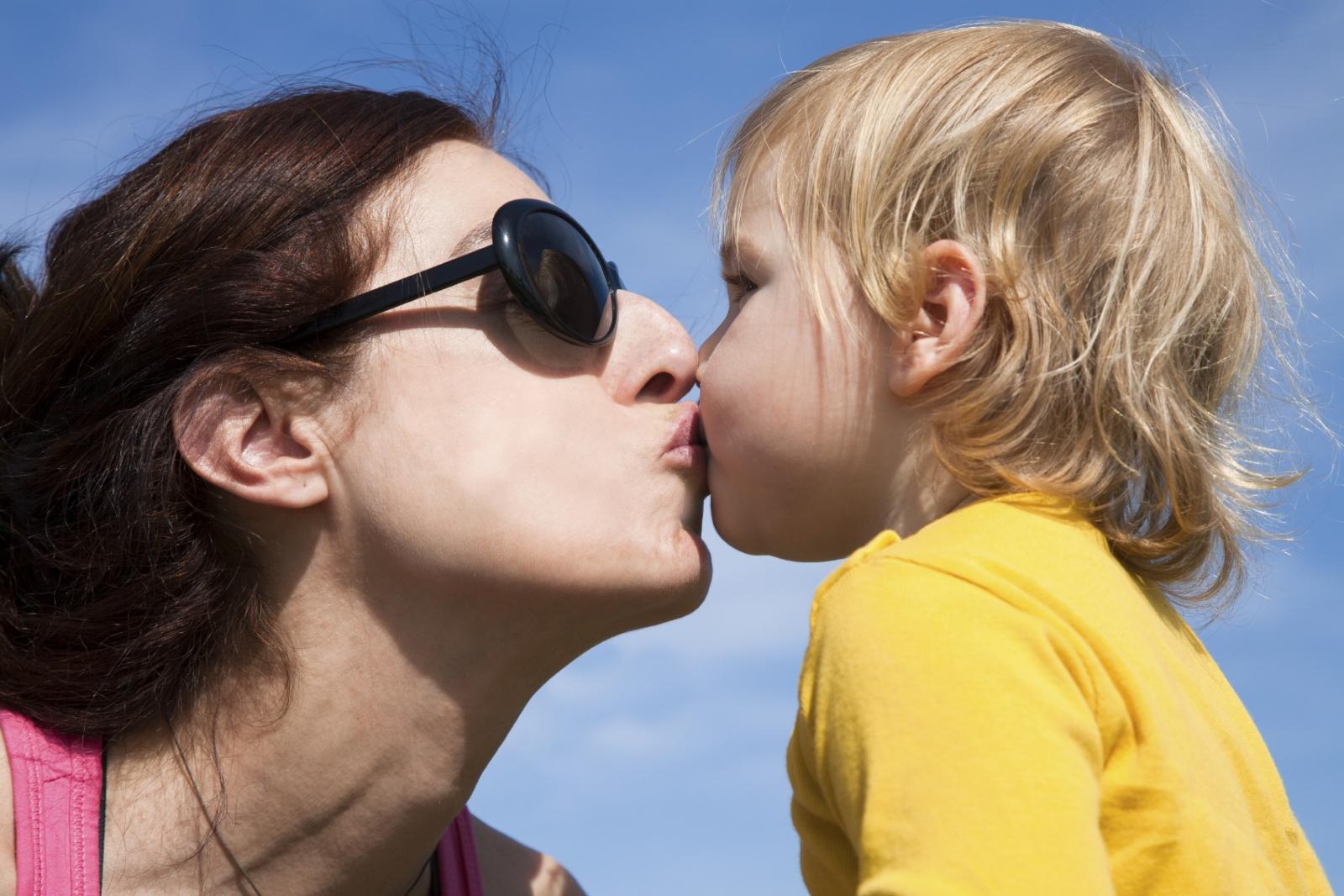 kissing child