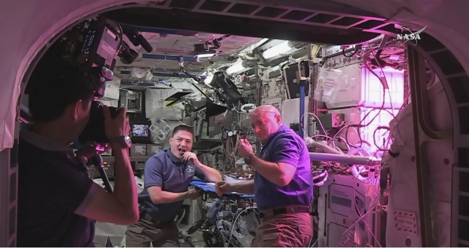 Astronauts Kjell Lindgren (L) and
