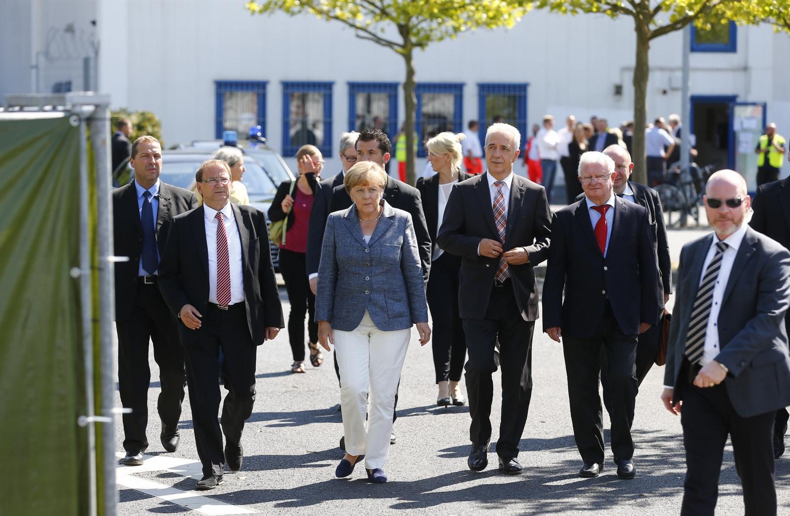 Angela Merkel booed refugee shelter