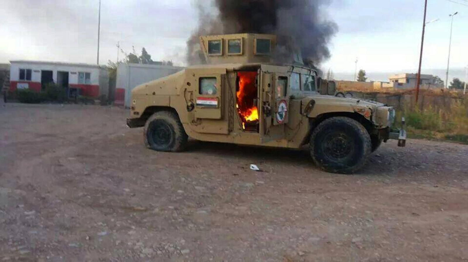 Military vehicle in Mosul in flames