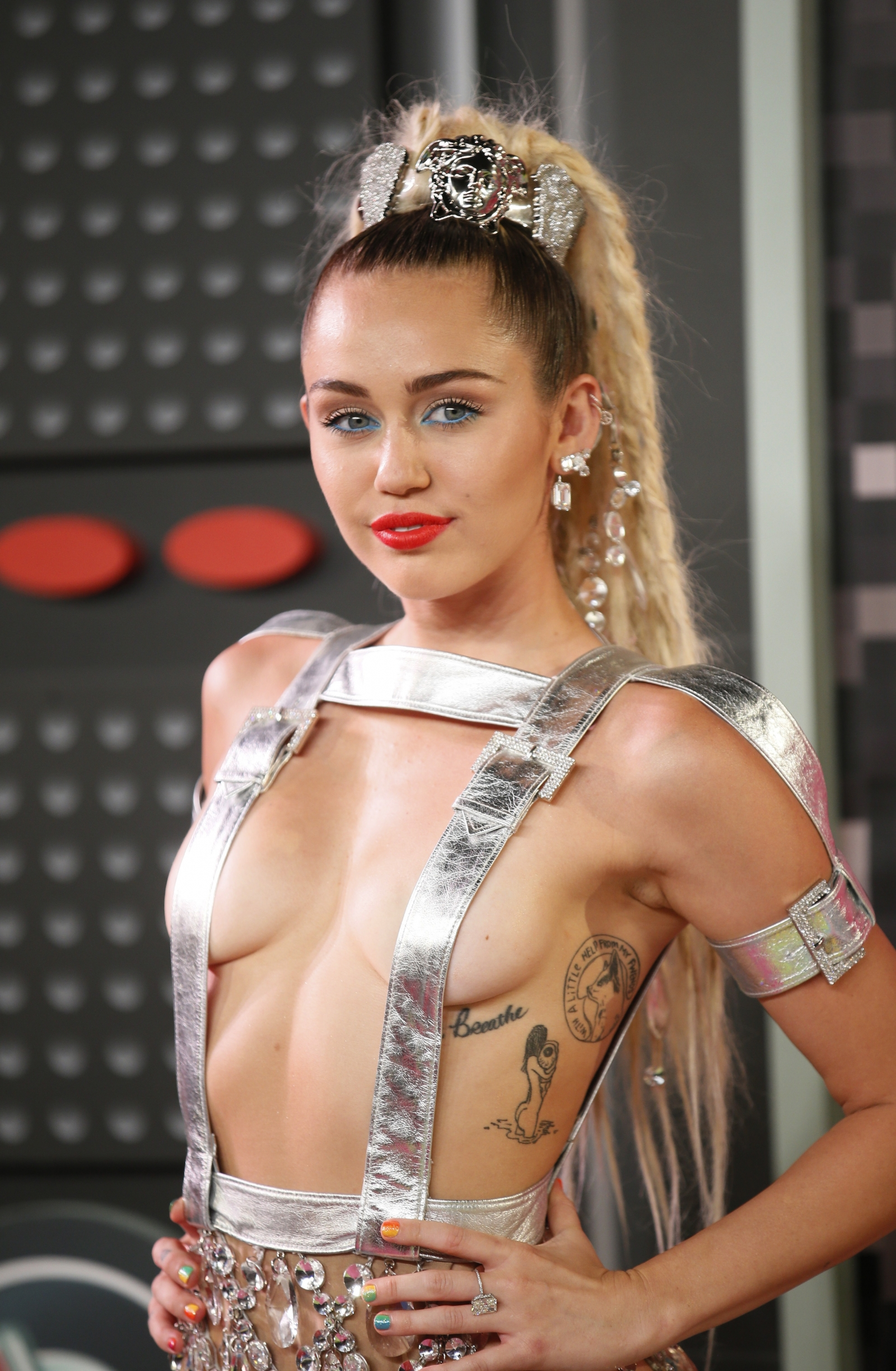 Miley cyrus boob fall out
