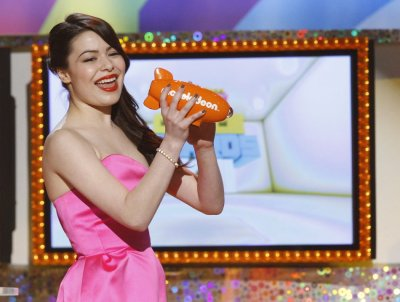 Actress Miranda Cosgrove accepts the Favorite TV Show award for quotiCarlyquot at the 24th annual Nickelodeon Kids039 Choice Awards in Los Angeles