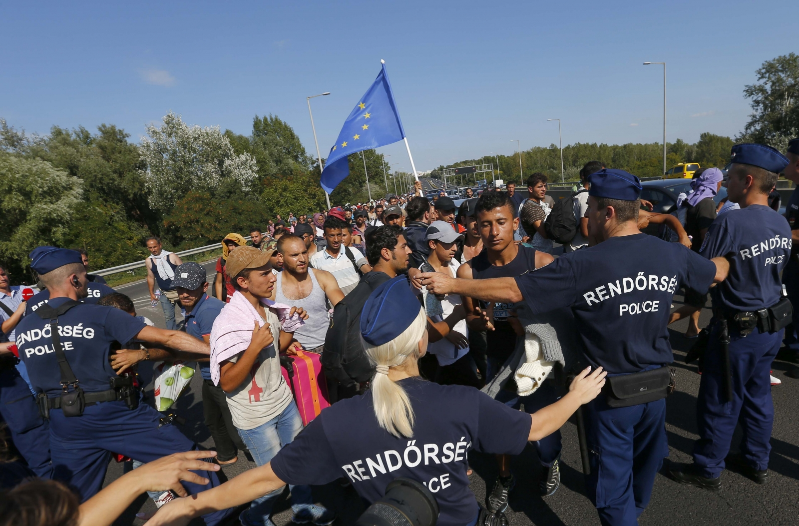 Migrants march along the highway