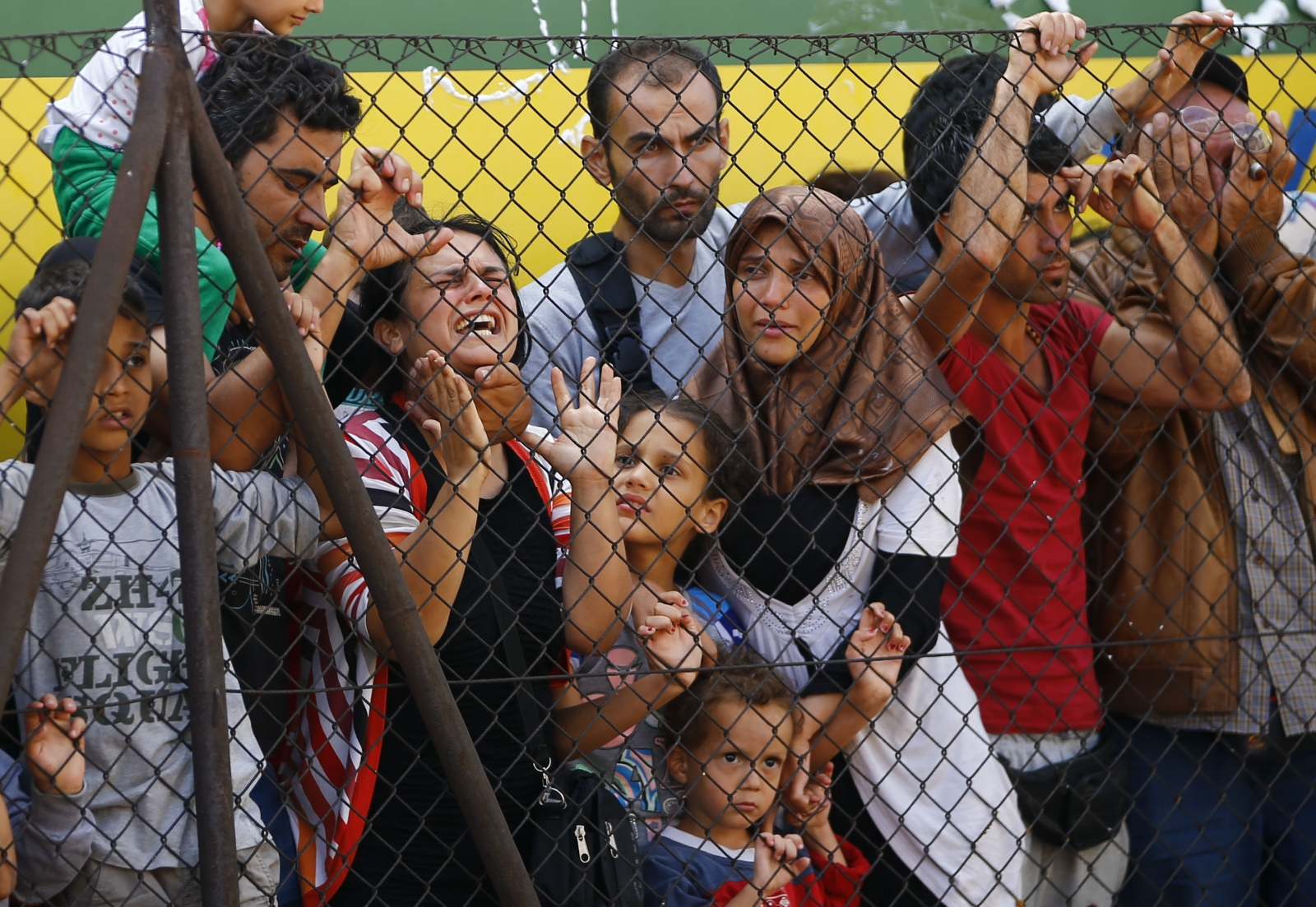Migrants wait in Bicske Hungary