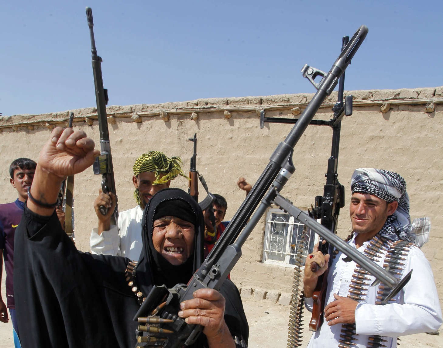 Iraq woman and sons holding guns