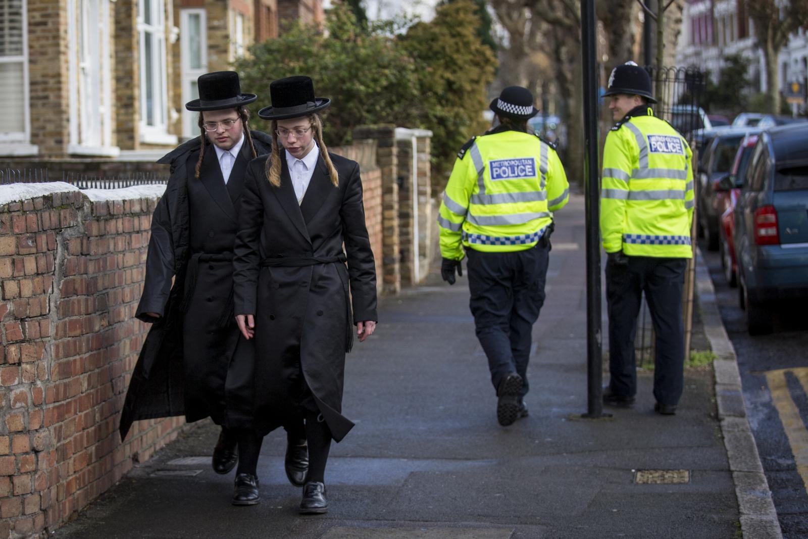 Jewish men walk in London