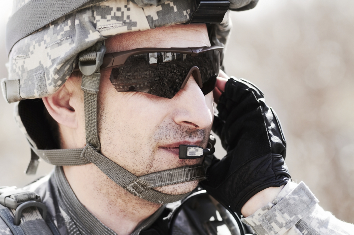 A soldier talking on a radio headset