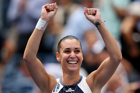 Flavia Pennetta of Italy celebrates match point against Petra Kvitova of  the Czech Republic during their