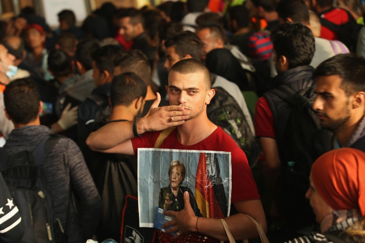 Migrant angela merkel