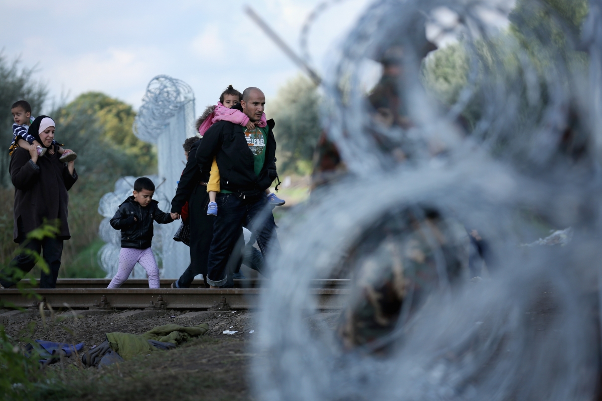 Refugees pass over the Hungarian border