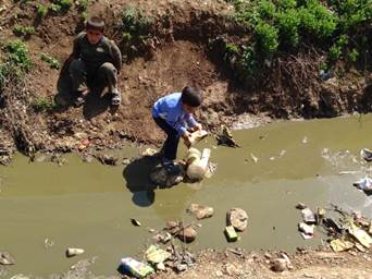 Syrian refugees play near polluted water Lebanon