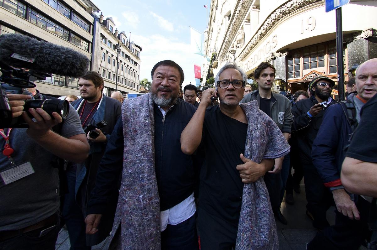Ai Weiwei and Anish Kapoor walking
