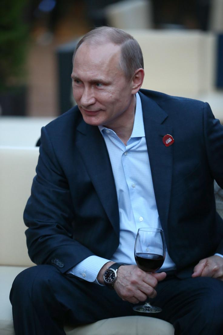 Putin enjoys a tipple during the Sochi